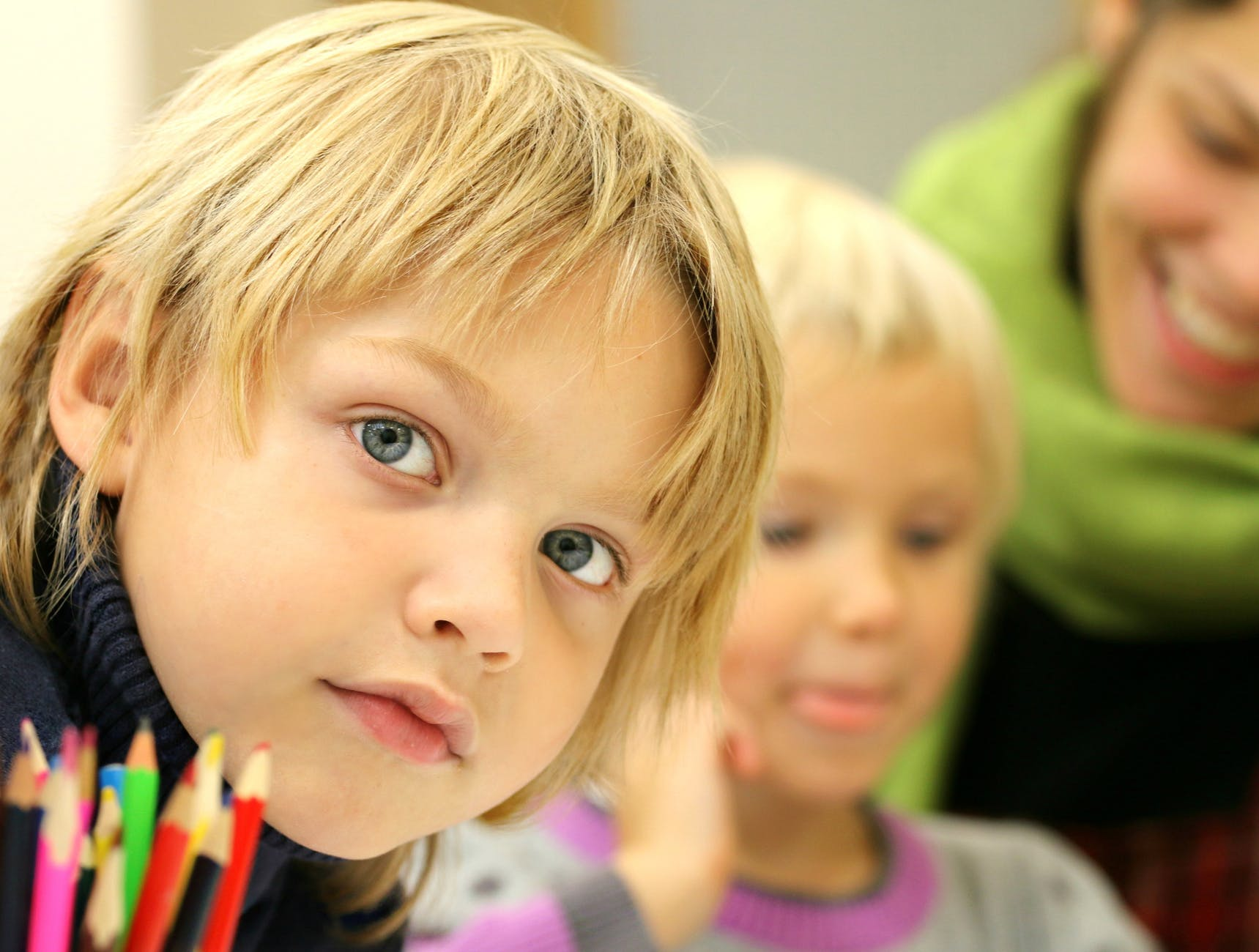 boy up close with colored pencils in front of him during home school class